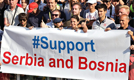 "Novak Djokovic (4-R) poses for a photo with a banner reading ""#support Serbia and Bosnia"""
